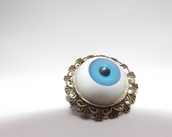 eye ball on bronze brooch