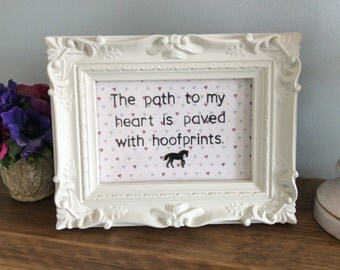 Horse quote in ornate frame.