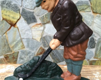 Cast iron  golfer doorstop