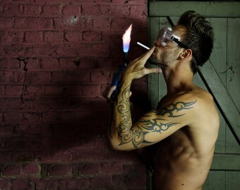 Portrait of a tattooed man / Portrait of a young tattooed man