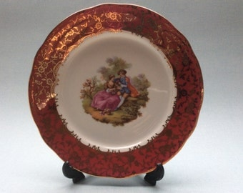 Vintage Fragonard courting couple plate with gold flowers
