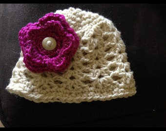 Handmade Infant hat made from lambs wool, with a crocheted flower that is removable.