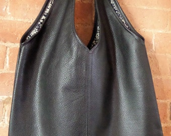 Black leather print lined tote bag