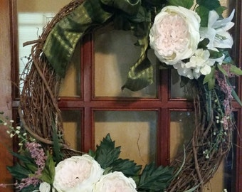 18'' x 20'' oval wreath with cream flowers