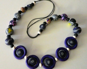 fimo necklace with purple rings