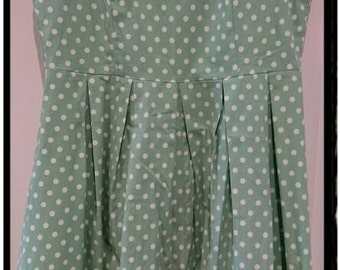 Vintage green dress with white polka dots.