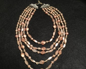 5 Strand vintage taupe bead necklace .