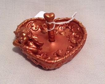 Copper color ring holder