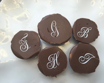 Monogrammed chocolate peanut butter candies