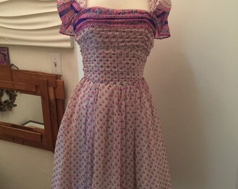 Vintage late 50's/60's flirty party dress made from Lord Hamilton fabric with ruched bodice