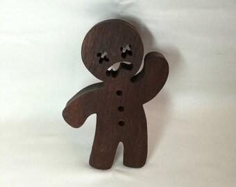 Handmade Jarrah gingerbread-man door-stop