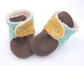 Teal + gold baby booties with unique angle cut and triangle design. Gender neutral, perfect for a boy or girl.
