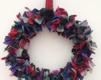 Multi coloured tartan wreath