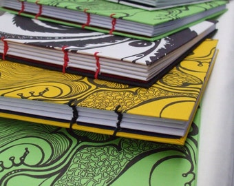Coptic bound notebooks with organic inkwork covers