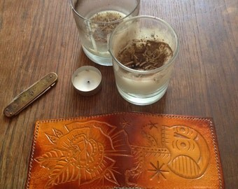 Traditional tattoo carved leather wallet