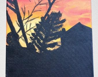 Orange and Red Sunset behind Dark Scenery