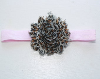 Leopard print shabby flower on a light pink stretch headband. Baby/Toddler. Hair accessory.