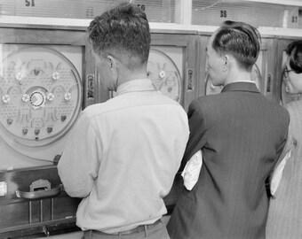 Japanese men gaming, 1970's  by Marvin Koner