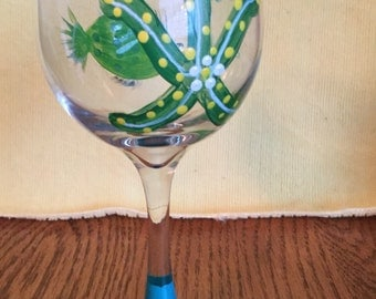 Wine glass with fish and starfish