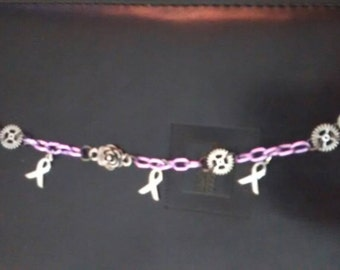 A beautifully unique steampunkish breast cancer awareness bracelet
