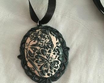 Dark green polymer clay cameo necklace