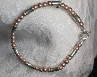 Aunt Pearl: Pale pink glass pearls with silverplated spacers, silvertone round clasp. SimplyElegantKathy