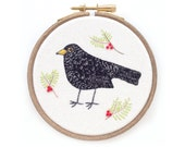 Hand embroidery of a blackbird, framed in a hoop, bird, hoopla, hoop art, original textile art, hand stitched