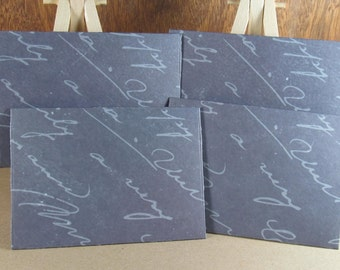 4 mini A7 handmade envelopes in slate grey with text, coloured inside