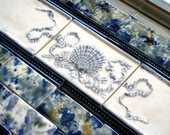 Azure Blue Shell and Ribbon tiled backsplash with mottled glaze field tile