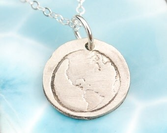 TINY EARTH, circle, eco-friendly nickel free white bronze pendant. Handcrafted by Chocolate and Steel.