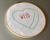 Weed - hand drawn and embroidered converstion hearts hanging