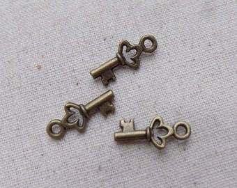 20 Small Antique Bronze tone Key Charms 18mm