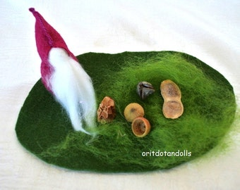 Little felt gnome and his treasuries, nature corner for  children play, typical to waldorf education.