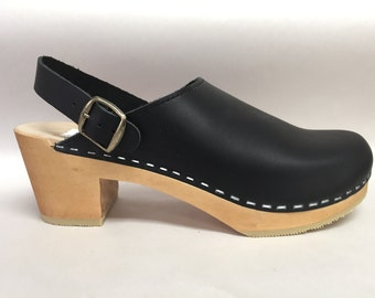 Black oiled medium heel clog on natural with ankle strap and bronze buckle
