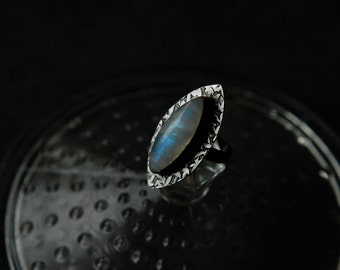 Natural rainbow blue fire moonstone oxidized sterling silver ring with marquise shaped textured leaves setting. Size 6.5