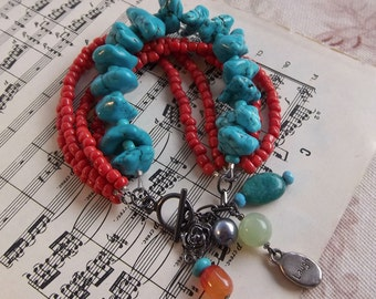 Funky multi-strand bracelet with colorful dangling charms