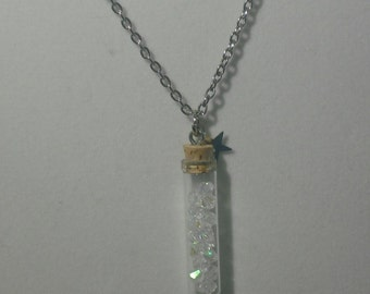 Mini bottle filled with crystal beads and star charm necklace