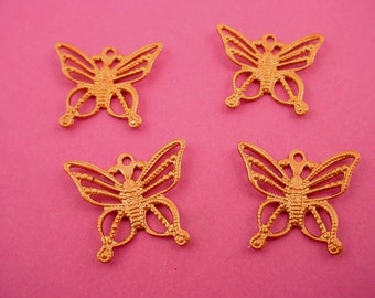 4 brass  butterfly open filigree charms 15mm curved wings