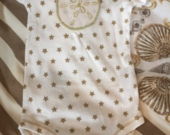 Sand Dollar on a star print onesie Nautical beach style size 3 to 6 months