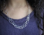 Extra long interchangable sterling silver link chain.