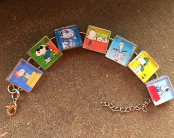Snoopy doing what Snoopy does best.... Fun character bracelet FREE USA SHIPPING