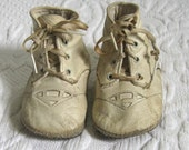 kid glove shoes . baby shoes .  cream colored kid baby shoes . leather shoes . Mrs. Day's ideal baby shoe . doll shoes . infant shoes