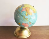1960s globe bank with metal base, brass