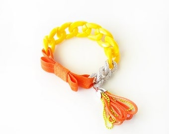 Funky Chunky Chain Bracelet - acrylic chain, aluminum chain, elastic ribbon bow, tiny handmade tassel - orange and yellow