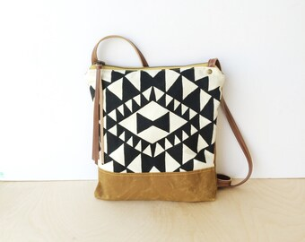 weekdayer • crossbody bag - waxed canvas• black and white geometric triangle print - brown waxed canvas - gifts under 50 • vukani