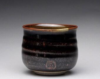 handmade ceramic tea bowl, pottery cup, teacup with black brown tenmoku and green celadon glazes
