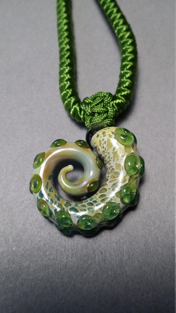Octopus Tentacle pendant for gals or guys and includes a cord or chain