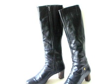 classy vintage 70s black genuine leather tall,  riding boots with a wood stacked heel. Made by Cobbies. Size 8N.