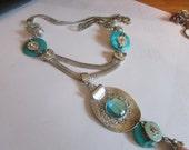 teal snake necklace