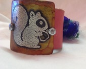 Etched metal squirrel cuff